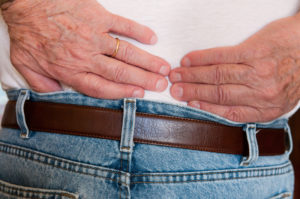 Chiropractic-Treatments-for-lower-back-pain-showing-hands-on-sour-back