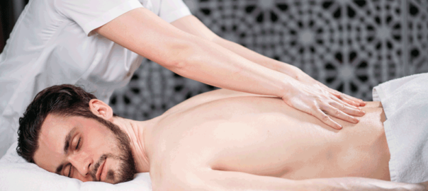 chiropractic-services-include-man-receiving-spinal-massagein Dallas, TX